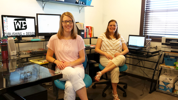 Michelle Stam (left) and Sarah Purdy (right) of the Write Place are settling into a new office space at 809 W 8th St., Suite 2.
