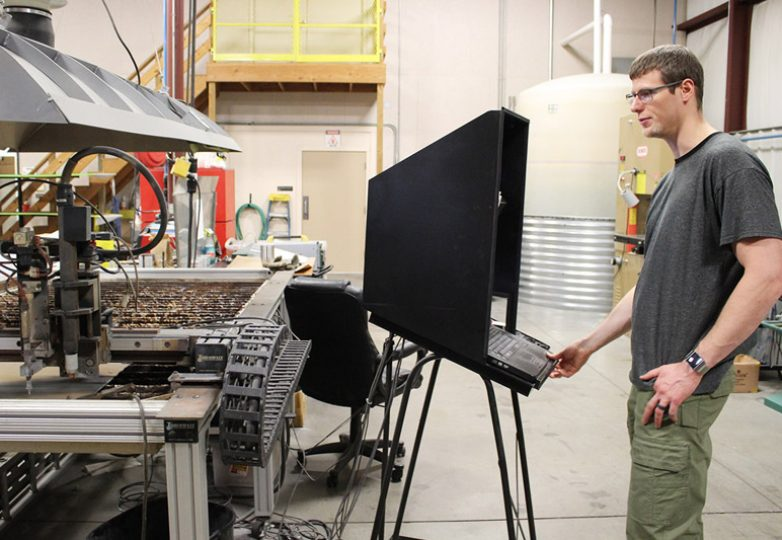 Co-Owner Jarid Purvis at the plasma cutter